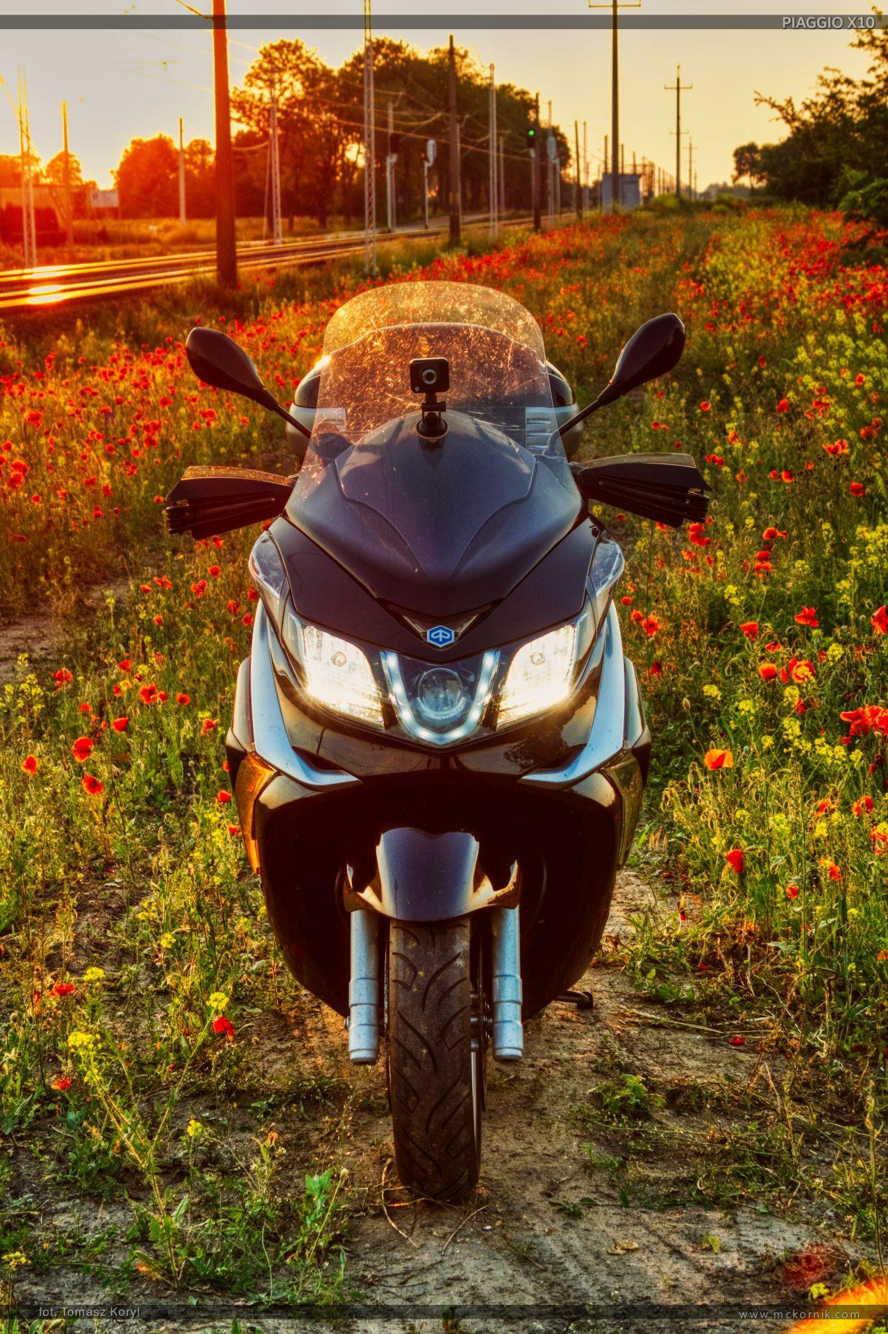 Sunset and Piaggio x10 350 motorcycle - mckornik.com