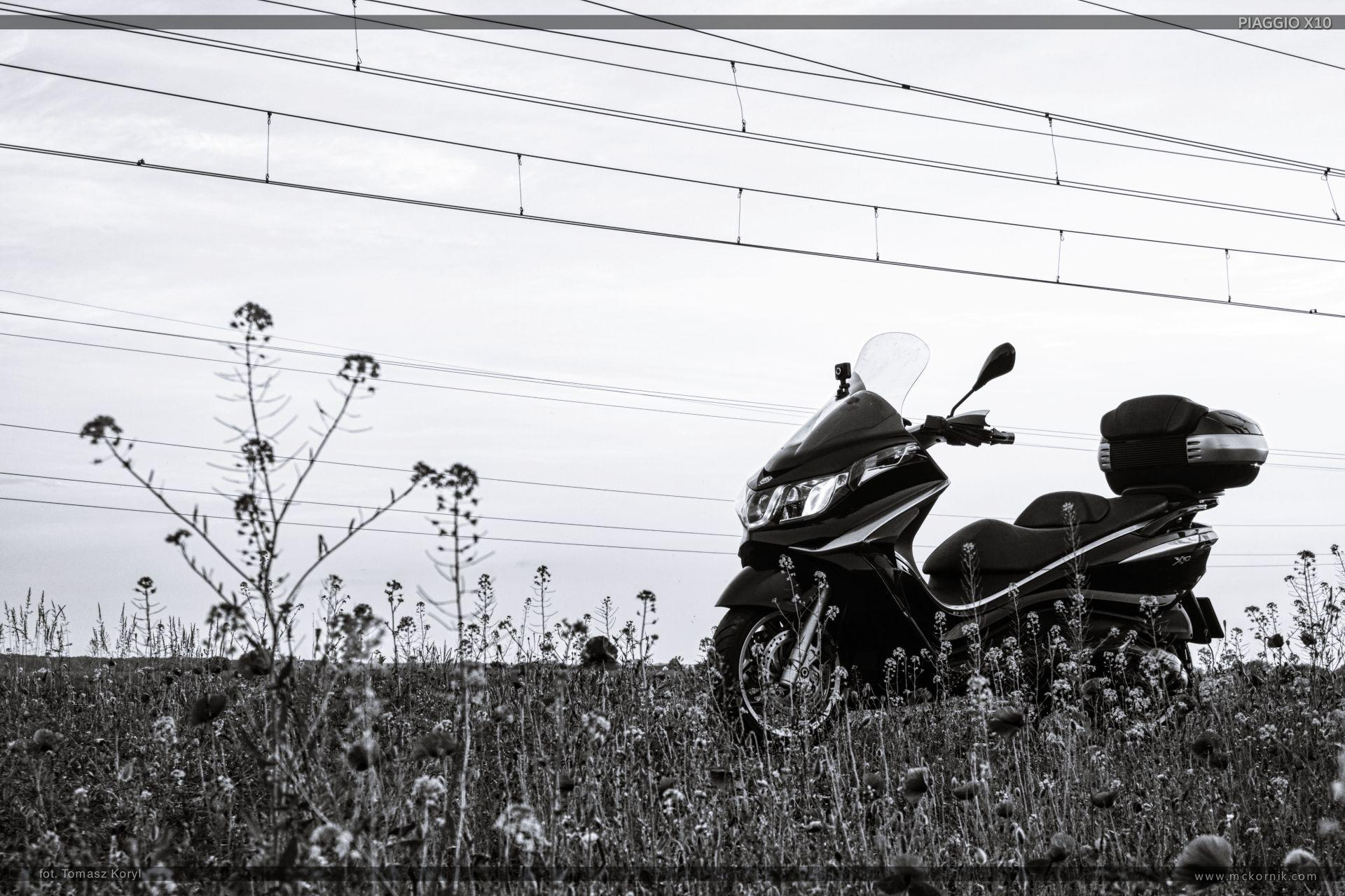 Black and white photo of maxi scooter piaggio x10 - mckornik.com - #scootertouring, #scooter, #scootertravel, #maxiscooter, #piaggio, #piaggioX10, #piaggio350